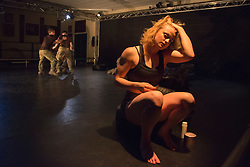 "© Licensed to London News Pictures. 07/05/2015. London, England. Female solo performed by Shelley Eva Haden with Worship of the female soldier. The Rosie Kay Dance Company perform ""5 Soldiers: The Body is the Frontline"" at The Rifles Officers' Club in Mayfair, London from 7 to 9 May 2015 before continuing a UK tour. 5 Soldiers gives an intimate view of the training that provides soldiers for combat and warfare and how the experience affects those that put their life on the line. Dancers: Duncan Anderson, Shelley Eva Haden, Chester Hayes, Sean Marcs and Oliver Russell. Choreographed and directed by Rosie Kay.  Photo credit: Bettina Strenske/LNP"