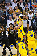 Golden State Warriors center JaVale McGee (1) blocks a Milwaukee Bucks shot at Oracle Arena in Oakland, Calif., on March 29, 2018. (Stan Olszewski/Special to S.F. Examiner)