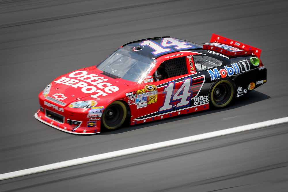 May 24, 2012; Concord, NC USA; NASCAR Sprint Cup Series driver Tony Stewart (14) during  for the Coca-Cola 600 at Charlotte Motor Speedway. Photo by Kevin Liles/kevindliles.com