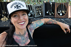 Heyltje Rose in her jewelry vendor booth at the Born Free chopper show. Silverado, CA. USA. Sunday June 24, 2018. Photography ©2018 Michael Lichter.
