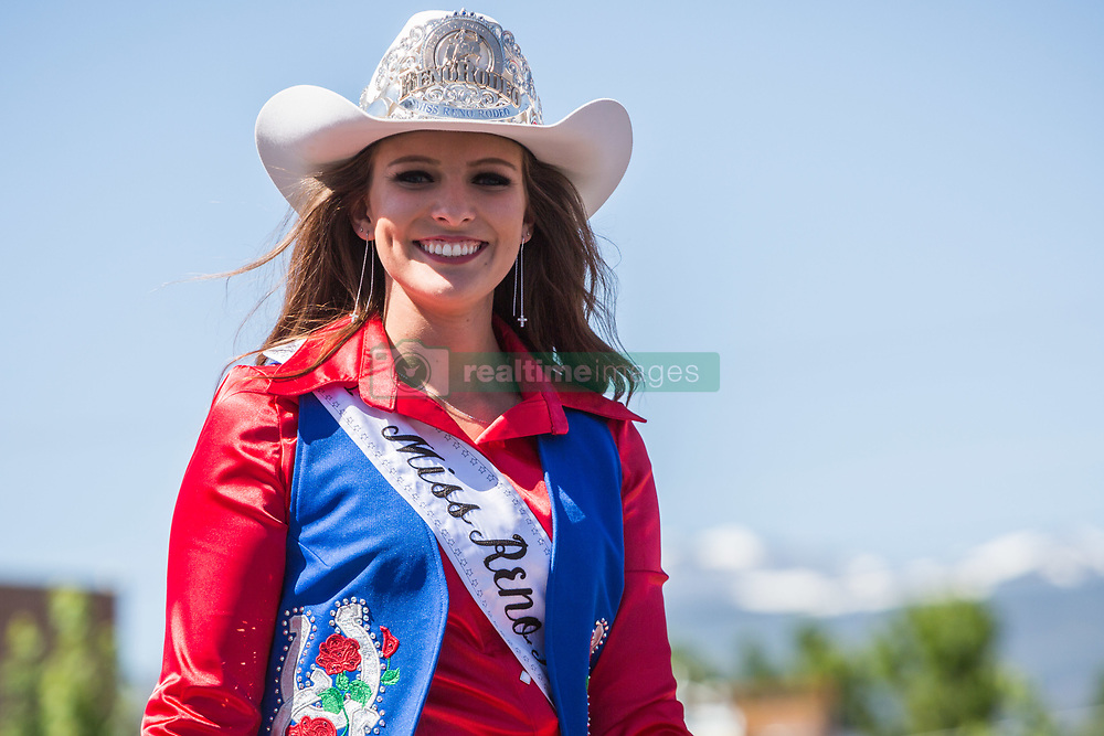 June 16, 2018 - Reno, Nevada, U.S - Saturday, June 16, 2018.Miss Reno Rodeo 2018, JENNIFER FISK, waves to onlookers during the Reno Rodeo Parade as it moves along South Virginia Street in midtown Reno, Nevada. The Reno Rodeo is a Professional Rodeo Cowboys Association (PRCA) sanctioned sporting event, and one of the top five rodeos in North America. Reno Rodeo is a non-profit organization made up of over 1,000 volunteers. This yearÃ•s rodeo, the 99th annual, runs from June 14-23, 2018. (Credit Image: © Tracy Barbutes via ZUMA Wire)