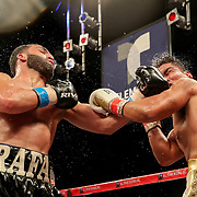 KISSIMMEE, FL - MARCH 05: Rafayel Simonyan (L) exchanges blows with Abraham Tebes during the Boxeo Telemundo All Star Boxing event at Osceola Heritage Park on March 5, 2021 in Kissimmee, Florida. (Photo by Alex Menendez/Getty Images) *** Local Caption *** Rafayel Simonyan; Abraham Tebes