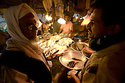Buyers select fish at the Sonargaon market in Sonargaon, outside Dhaka, Bangladesh.