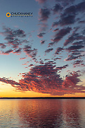 Vivid sunrise clouds over Fort Peck Reservoir in the CM Russell National Wildlife Refuge near Fort Peck, Montana, USA