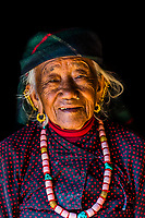 A 96 year old Gurkha woman wearing a turquoise necklace, Chitepani village, near Pokhara, Nepal.