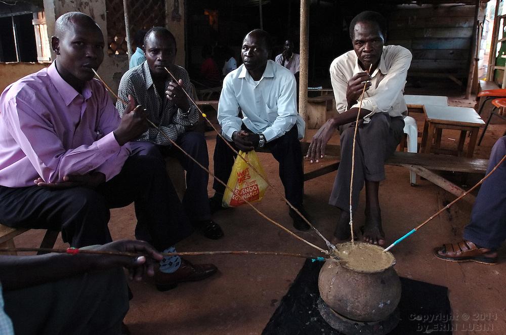 Men drink banana beer at a bar in Kampala, Uganda, October 3, 2006..Photo by Erin Lubin