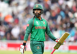 Bangladesh's Tamim Iqbal walks off after being caught by Australia's Josh Hazlewood from a ball by Mitchell Starc during the ICC Champions Trophy, Group A match at The Oval, London.