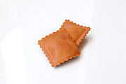 Fresh uncooked Sweet potato flavoured Ravioli (Stuffed Pasta) on white background