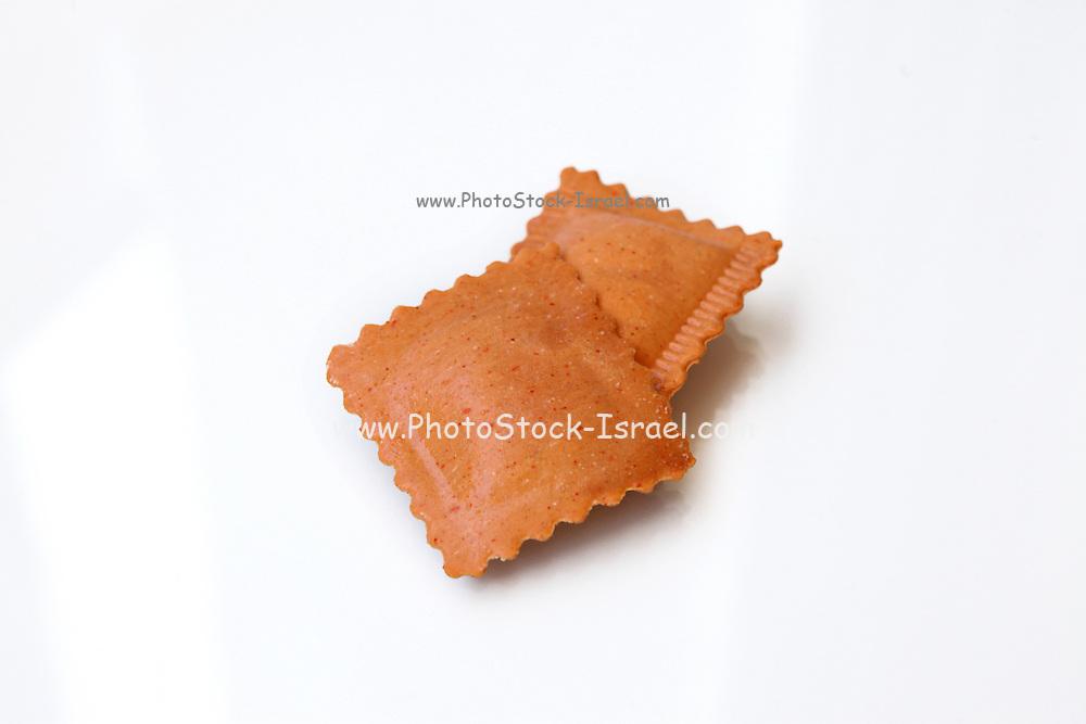 Fresh uncooked Sweet potato flavoured Ravioli (Stuffed Pasta) on white background