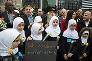 Thousands of people including police officers and Muslim faith leaders gathered on Westminster Bridge to hold a vigil and a minutes silence one week after the terror attack, on March 29th 2017 in London, United Kingdom. Local Muslim children carrying placards voicing Islam against terror and that Islam means peace.