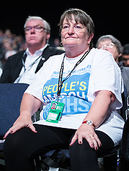 "© Licensed to London News Pictures . 24/09/2014 . Manchester , UK . A woman wearing t-shirt reading "" PEOPLE'S MARCH FOR THE NHS"" at the conference . The Labour Party Conference 2014 . Photo credit : Joel Goodman/LNP"