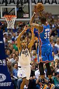 Kevin Durant (35) of the Oklahoma City Thunder shoots the ball over Brandan Wright (34) of the Dallas Mavericks at the American Airlines Center in Dallas on Sunday, March 17, 2013. (Cooper Neill/The Dallas Morning News)
