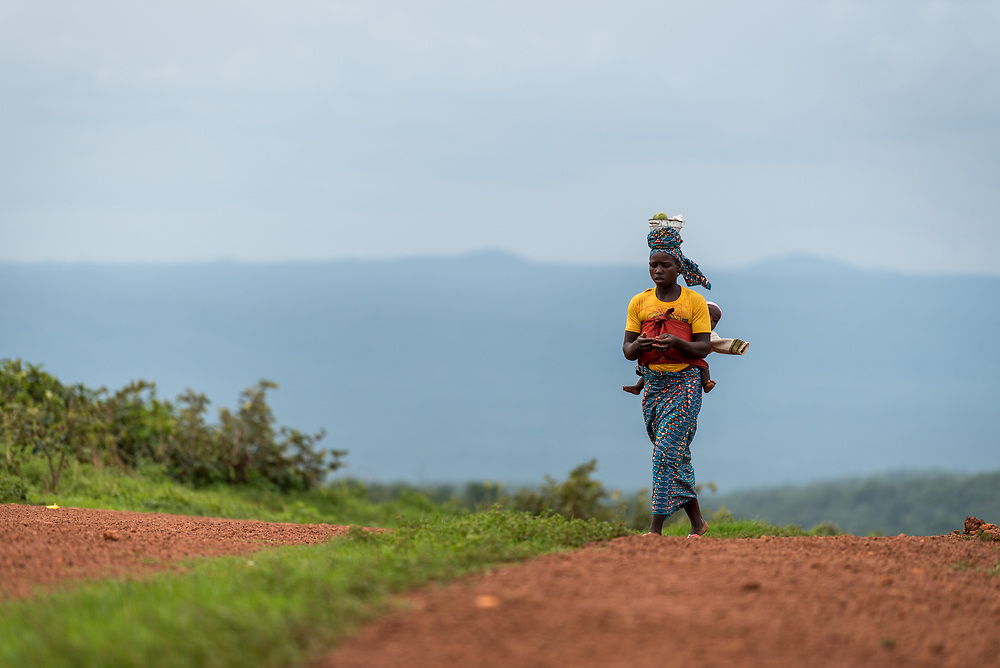 3 June 2019, Djohong, Cameroon: A woman walks along the road from the Borgop refugee camp towards the host community of Borgop. The Borgop refugee camp is located in the municipality of Djohong, in the Mbere subdivision of the Adamaoua regional state in Cameroon. Supported by the Lutheran World Federation since 2015, the camp currently holds 12,300 refugees from the Central African Republic.