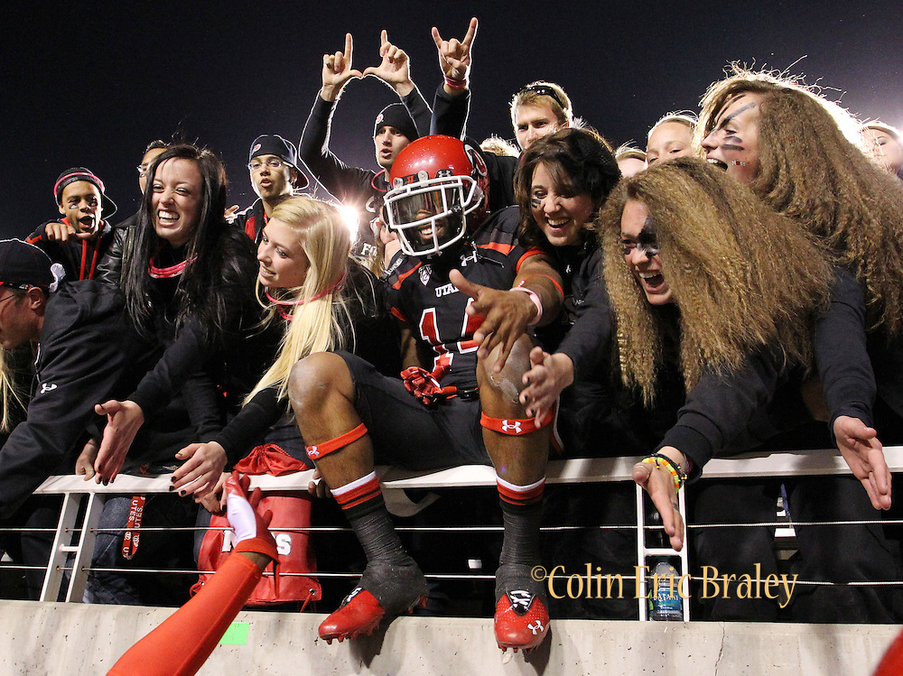Utah wide receiver Reggie Dunn (14) celebrates with fans after the Utes' 27-8 win over Oregon State following an NCAA college football game at Rice-Eccles Stadium, Saturday, Oct. 29, 2011, in Salt Lake City.  (AP Photo/Colin E. Braley).