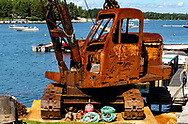 An Old rusted crane still in use in a small marina on Penobscot Bay, Maine