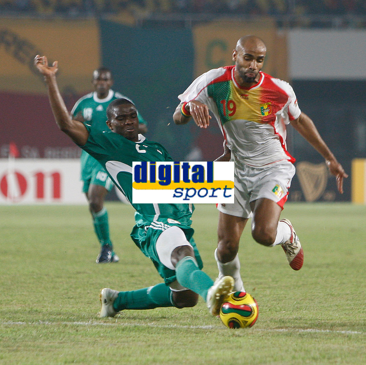 Photo: Steve Bond/Richard Lane Photography.<br />Nigeria v Mali. Africa Cup of Nations. 25/01/2008. Joseph Yobo (L) times his tackle on Frederic Kanoute (R) perfectly