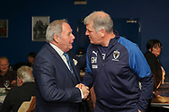 Peterborough United Barry Fry shaking hands with AFC Wimbledon manager Glyn Hodges during the EFL Sky Bet League 1 match between AFC Wimbledon and Peterborough United at the Cherry Red Records Stadium, Kingston, England on 18 January 2020.