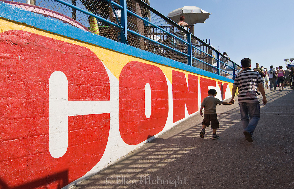 Entrance Ramp to the Coney Island boardwalk in Brooklyn, New York City. Located on a peninsula in southern Brooklyn, Coney Island is the site of a public beach, boardwalk and amusement park. Prior to the 1950's, it was the largest amusement area in the US, attracting several million visitors per year.