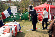 Policeman taking part in fete sideshow petanque game Newhaven, East Sussex, England