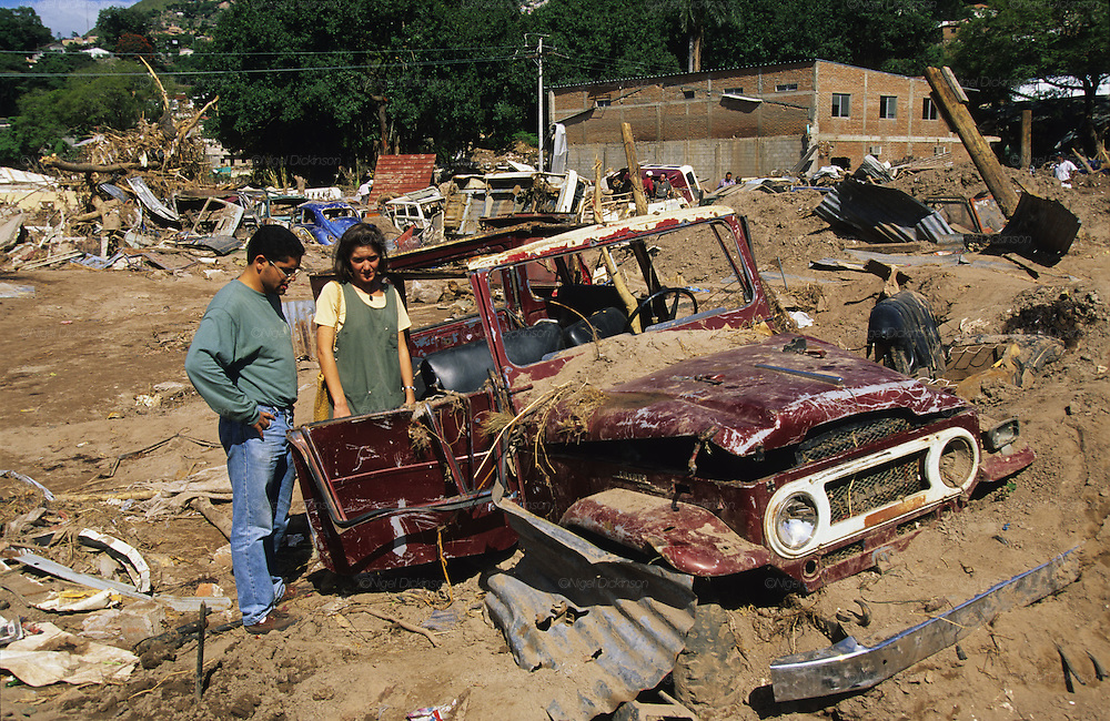 Central America, Honduras, Tegucigalpa. Buried car. Devastation in the aftermath of Hurricane Mitch. High winds and flooding. Infrastructure destroyed. Car park.