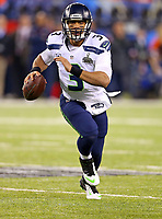 Seattle Seahawks quarterback Russell Wilson  during the NFL Super Bowl XLVIII football game against the Denver Broncos, Sunday, Feb. 2, 2014, in East Rutherford, N.J. The Seahawks won 43-8.<br /> <br /> Photo By Tom DiPace