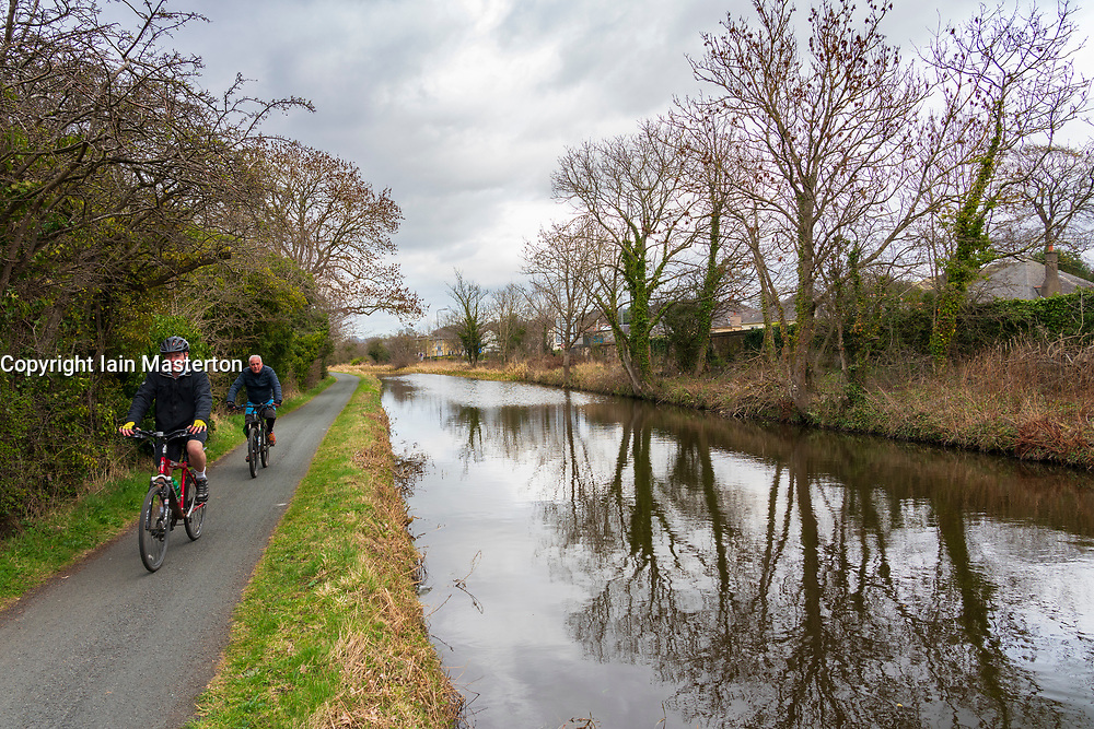 Cyclists on the towpath of the Union Canal in early spring  in Edinburgh, Scotland, UK