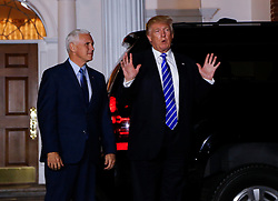 President-elect Donald (R) and Vice President-elect Mike Pence (L) leave the clubhouse of Trump International Golf Club, after a day of meetings, November 19, 2016 in Bedminster Township, New Jersey. (Aude Guerrucci / Pool)