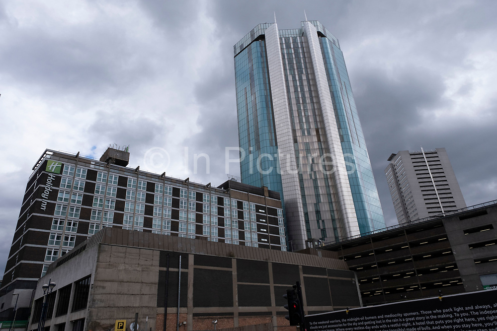 Radisson Hotel skyscraper high above older buildings in the city centre on 28th July 2020 in Birmingham, United Kingdom. Radisson Hotels is an international hotel chain headquartered in the United States and owned by Jin Jiang International Holdings Co.