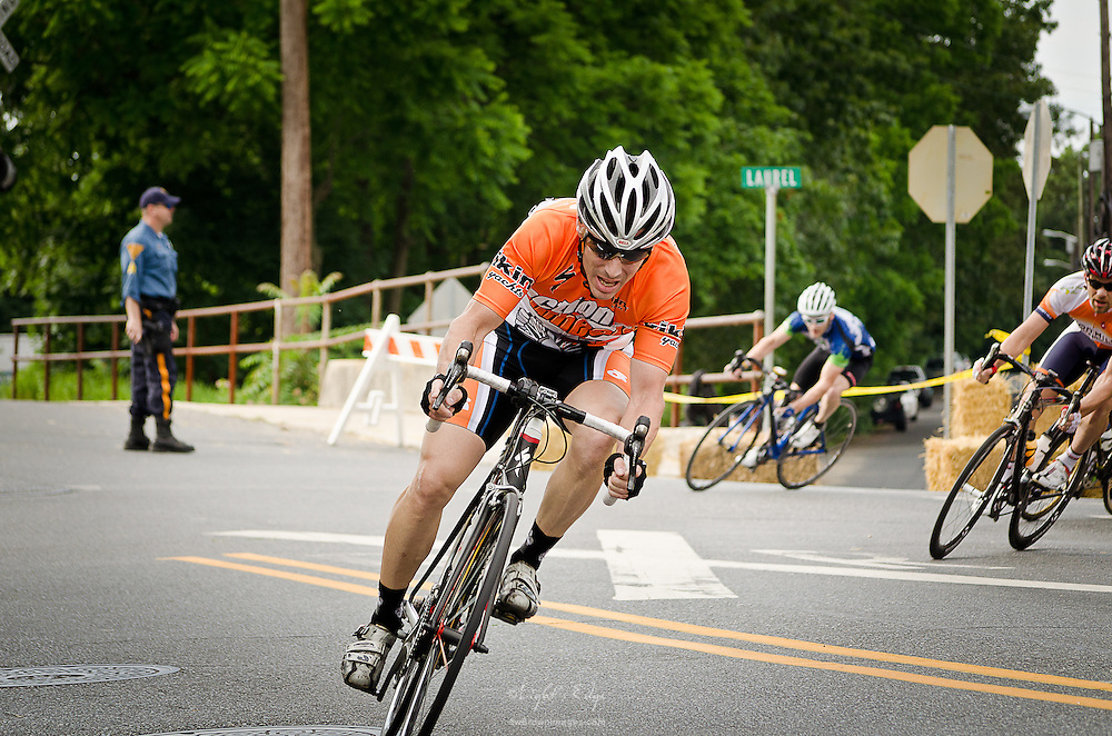 Rounding the corner of Laurel and Broadway during one of the races of the Bob Riccio Memorial bicycle races in Pitman, NJ.