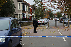 © Licensed to London News Pictures. 24/10/2020. London, UK. A police officer guards a crime scene on Westbury Road in Walthamstow, East London following the death of a 22 year old man. The victim was stabbed on Friday and was pronounced dead at the scene just before 10pm.  Photo credit: Dinendra Haria/LNP