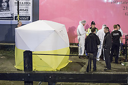 "© Licensed to London News Pictures . 06/10/2013 . Manchester , UK . The body is placed in a forensic tent , for examination . Police pull a body from The Bridgewater Canal in Manchester , adjacent to the City's "" Gay Village "" . The body was spotted yesterday (6th October) afternoon and a cordon was erected as specialist police divers recovered the body .. Photo credit : Joel Goodman/LNP"