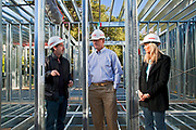 """Ed Begley Jr.,  Rachelle Carson-Begley and general contractor Scott Harris.  On 3/14/2013 the steel framing continues to be assembled over the foundation on the Begley's new home. Steel, while not a common material for residential framing, is 94% recyclable, has been milled locally for this project, and is a more sustainable choice than wood, which is typically used for residential building construction. Ed Begley Jr. (noted actor and environmentalist) and his wife Rachelle Carson-Begley are building their new home under LEED Platinum Certified standards in an attempt to become North America's greenest, most sustainable home. It is also being filmed for their web series """"On Begley Street."""" Studio City, California, USA"""