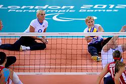 01-09-2012 ZITVOLLEYBAL: PARALYMPISCHE SPELEN 2012 USA - SLOVENIE: LONDEN.In ExCel South Arena wint USA van Slovenie / (L-R) Danica GOSNAK, Stefka TOMIC.©2012-FotoHoogendoorn.nl.
