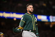 Oakland Athletics first baseman Yonder Alonso (17) walks off the field after being stranded on third base against the San Francisco Giants at AT&T Park in San Francisco, California, on March 30, 2017. (Stan Olszewski/Special to S.F. Examiner)