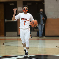 Quentin Richards (1) calls a play as he brings the ball down the court for the Gallup Bengals against the Grants Pirates Tuesday night at Gallup High School in Gallup.