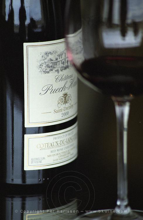 Chateau Peuch-Haut, St Drezery. Gres de Montpellier. Languedoc. France. Europe. Bottle. Wine glass.
