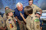 Boy scouts touch the Medal of Honor on recipient Mike Thornton during a campaign event for Gov. Rick Perry aboard the USS Yorktown June 8, 2015 in Mount Pleasant, South Carolina.