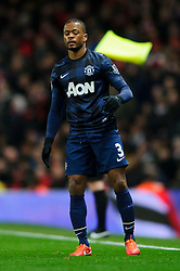 Man Utd Defender Patrice Evra (FRA) looks frustrated - Photo mandatory by-line: Rogan Thomson/JMP - 07966 386802 - 12/02/14 - SPORT - FOOTBALL - Emirates Stadium, London - Arsenal v Manchester United - Barclays Premier League.