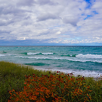 """""""Colors of Maple on Lake Superior"""" <br /> <br /> Enjoy the amazing colors of the beautiful blues and greens of the waters of Lake Superior. Feel the movement of the clouds above, and relish in the contrast of fall color against the greens of the sand grass on a windy autumn day!"""