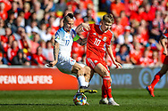 Slovakia Marek Hamsik tussles with Wales midfielder David Brooks during the UEFA European 2020 Qualifier match between Wales and Slovakia at the Cardiff City Stadium, Cardiff, Wales on 24 March 2019.