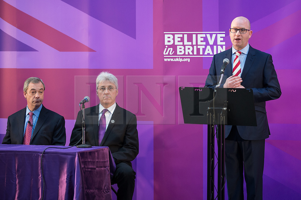 © Licensed to London News Pictures . 23/03/2015 . Middleton , UK . Paul Nuttall speaks as Nigel Farage and UKIP candidate for Heywood and Middleton , John Bickley , listen . UKIP leader Nigel Farage , Deputy Leader Paul Nuttall and Economics Spokesman Patrick O'Flynn announce UKIP's economic policy at Concept Metal Products and Co Ltd in Middleton , Lancashire . Photo credit : Joel Goodman/LNP