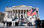 A U.S. military honor guard carries the casket of former U.S. President Gerald Ford down the steps of the U.S. Capitol for transport to Ford's State funeral in Washington January 2, 2007.   REUTERS/Jim Young