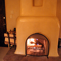 North America, USA, New Mexico, Santa Fe. Fireplace at Inn of Five Graces