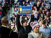 16 MARCH 2019 - BLOOMINGTON, MINNESOTA, USA: A person holds up a sign calling for community solidarity at Dar al Farooq Center in Bloomington. An interdenominational crowd of about 1,000 people came to the center to protest white supremacy and religious intolerance and to support Muslims in New Zealand who were massacred by a white supremacist Friday. The Twin Cities has a large Muslim community following decades of Somali immigration to Minnesota. There are about 45,000 people of Somali descent in the Twin Cities.   PHOTO BY JACK KURTZ