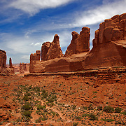 "Called Park Avenue, the sheer walls of this narrow canyon in Arches National Park reminded early visitors of buildings lining a big city street. These geologic ""skyscrapers"" tell the story of three rock layers millions of years old."