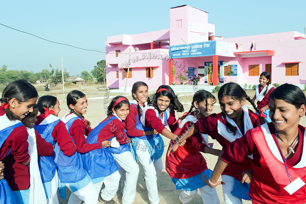 Ritu Gaur, 13, (centre) is playing the game of Kabaddi in front of the Jamoniya Tank Girls Hostel, near Sehore, Madhya Pradesh, India, where the Unicef India Sport For Development Project has started in 2012. Covering 313 state-run girls' hostels and 207 mixed hostels in Madhya Pradesh, the project ensures that children from Scheduled Tribes (ST) and others amongst the poorest people in India, can easily access education and be introduced to sports. Field workers from Unicef also oversee their nutrition and monitor the overall conditions of each pupil.