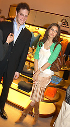 LORD FREDERICK WINDSOR and MISS DASHA ZHUKOVA at a party to celebrate the 2nd anniversary of Quintessentially magazine held at Asprey, Bond Street, London on 24th February 2005.<br />