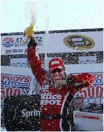 HAMPTON, GA: Carl Edwards celebrates in victory lane   after winning the Pep Boys Auto 500 at Atlanta Motor Speedway on Sunday10/26/08, © 2008 Johnny Crawford