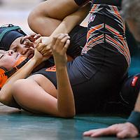 Wingate Bear Erin Lewis locks down Gallup Bengal Logan Barber Wednesday at Wingate High School.