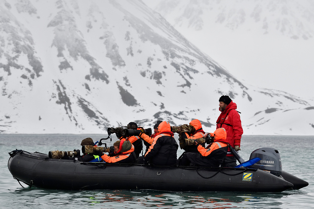 Nature photography ecotourists in a Zodiac inflatable boat, Svalbard, Spitzbergen, Arctic Norway
